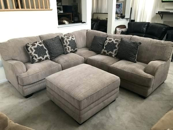 ashley furniture joliet il light taupe sectional sofa with accent pillows storage ottoman platinum by ashley furniture homestore mall loop drive joliet il